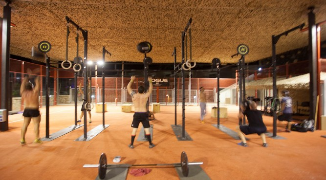 CrossFit Box with athletes preparing for the next workout