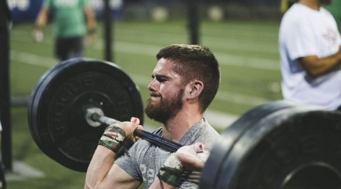CrossFit Athlete tries to push up the weight at Canarias Gone Bad 2018. the Barbell lays on his shoulders and he tries to stand up. Click here for more of Canarias Gone Bad.