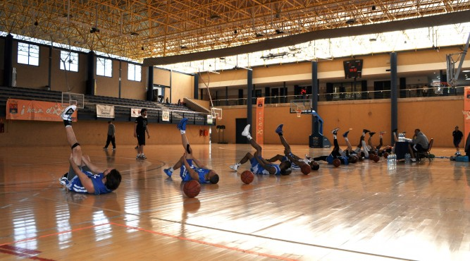 Basketball players stretching