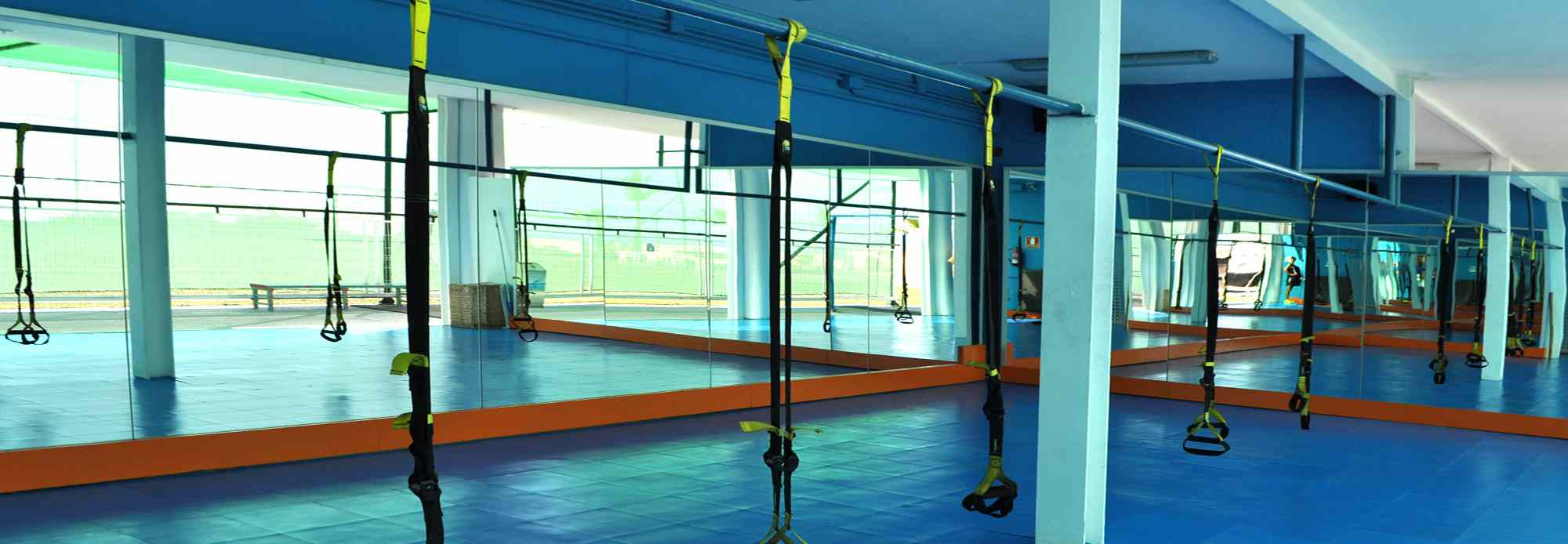 The multi-purpose area of our semi-outdoor gym is perfect for group and sling trainer sessions