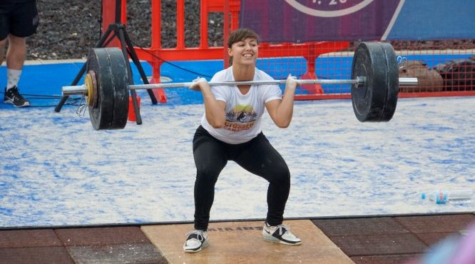 girl smiles during wieght lifting in the CrossFit Survival Top Training Box