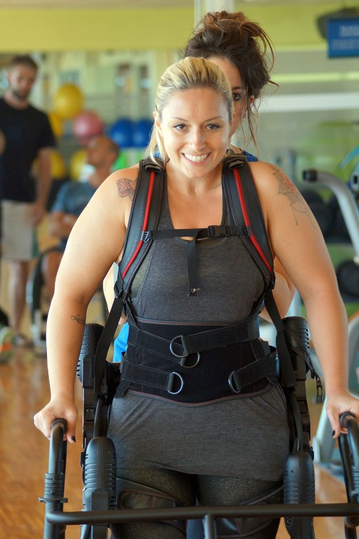 Disabled Female Tennis Player is walking with a special construction. She is smiling.