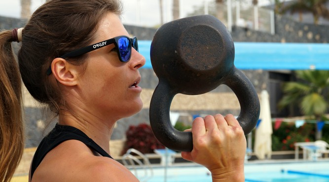 Viktoria Schwarz trains beside the Olympic Pool with a Kettlebell