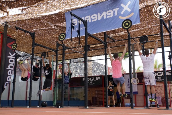 Six CrossFitter train pull-ups as our Level 1 Trainer observes