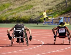 Two para-athletes during their warm up for wheelchair racing